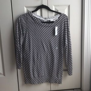 Grey sweater with black and white design